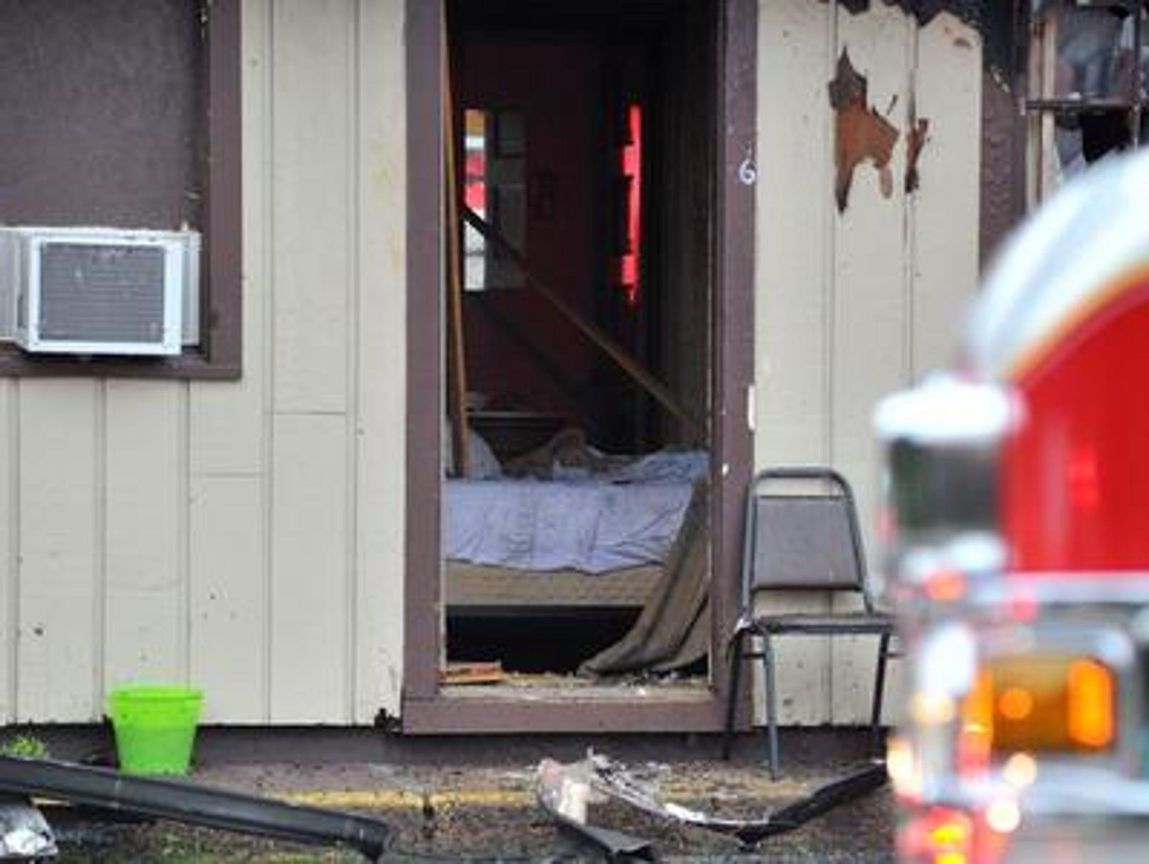 Twenty-seven people lived in the Ponderosa Motel. Many