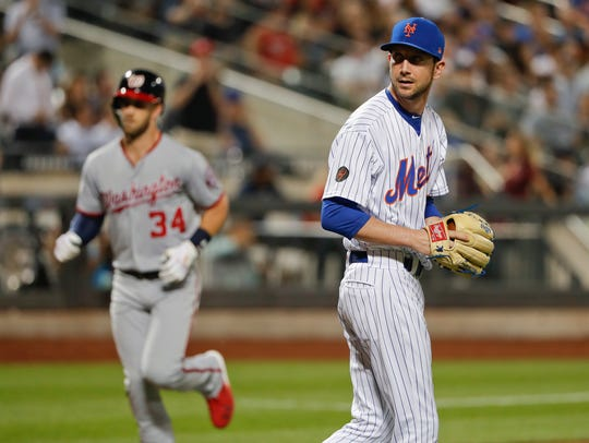 New York Mets relief pitcher Jerry Blevins waits after