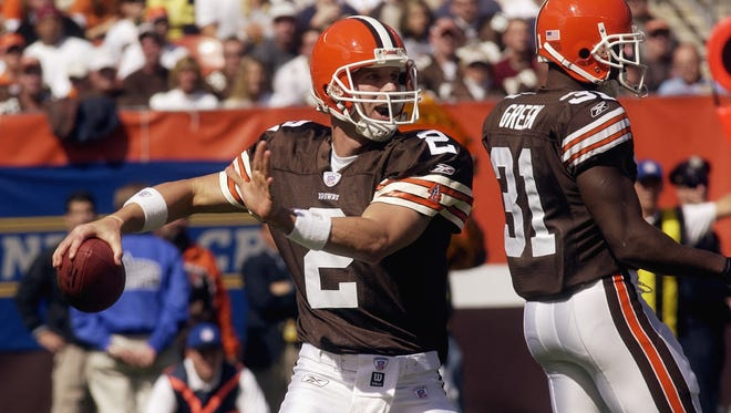 Quarterback Tim Couch of the Cleveland Browns throws a pass against the Cincinnati Bengals at Cleveland Browns Stadium on September 28, 2003 in Cleveland, Ohio.