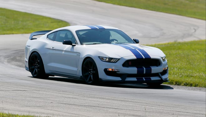Ford engineers took the first public laps  for the new  Ford Shelby GT 350 R Mustang at the Gratten Raceway in Belding in western Michigan on Tuesday.