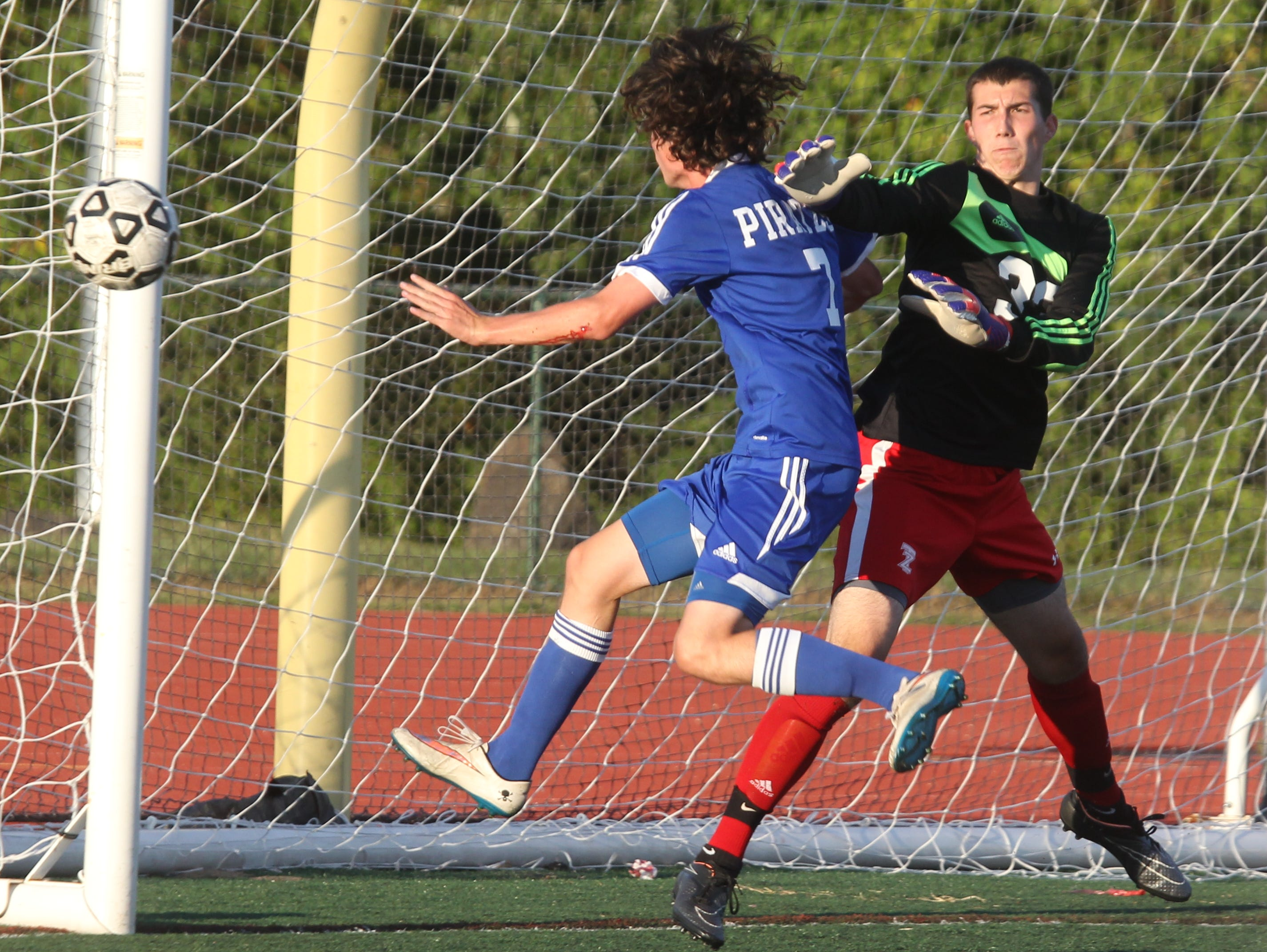 Pearl River's Brian Flaherty heads the ball wide of the net and Tappan Zee goalie John Connor during a game at Tappan Zee Sept. 24, 2015. Pearl River won1-0.