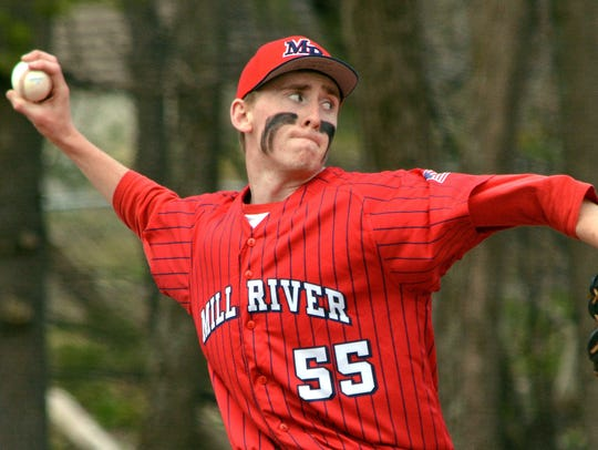 Mill River pitcher Lincoln Pritchard rears back and