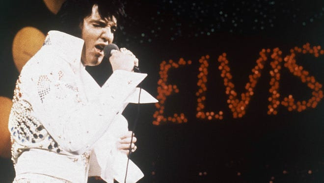 This 1972 file photo shows Elvis Presley during a performance.