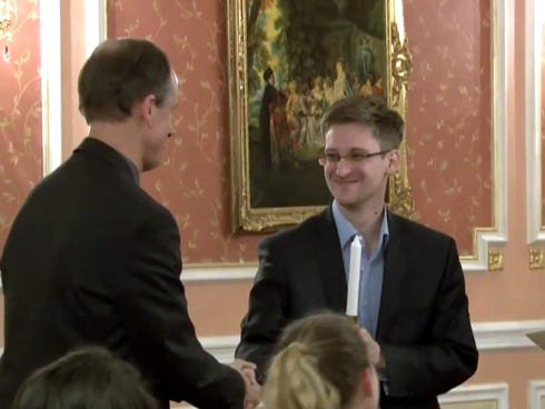 In this image made from video released by WikiLeaks on Oct. 11, 2013, former National Security Agency systems analyst Edward Snowden, center, receives the Sam Adams Award in Moscow, Russia.