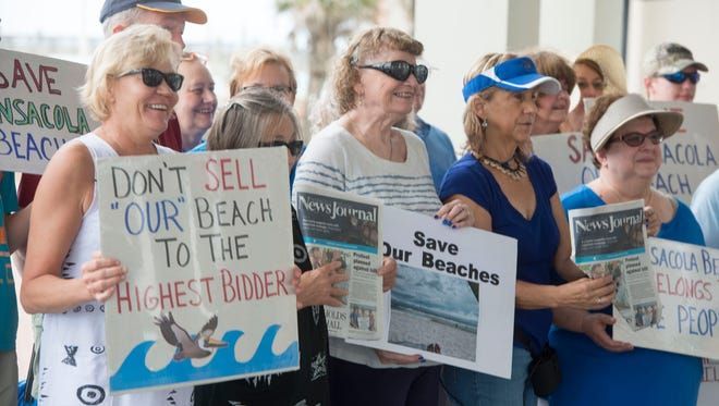 Protesters gather at the pavilion at Pensacola Beach on Aug. 5, 2017, during a Save Pensacola Beach rally.