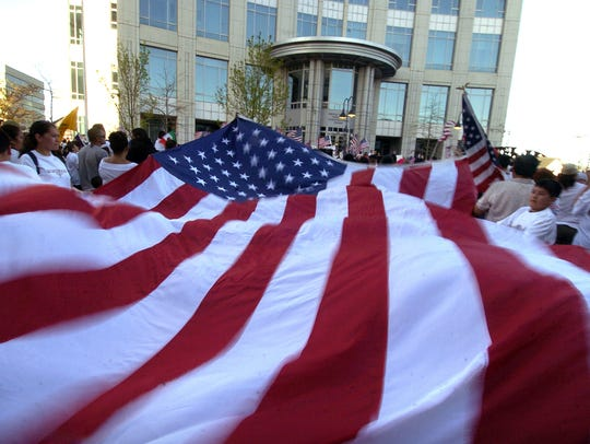 An American flag waves during an immigration protest in front of the federal building in downtown Reno.
