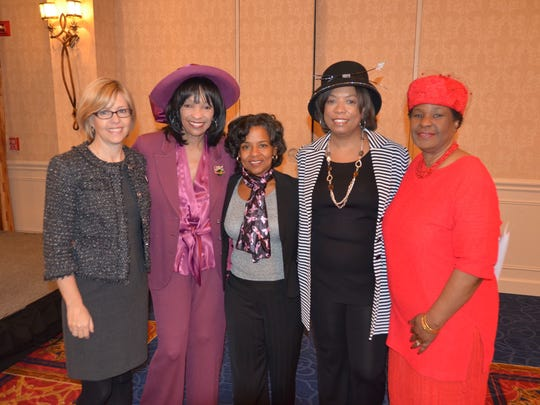 Women at the 2014 hat tea, left to right: Komen for