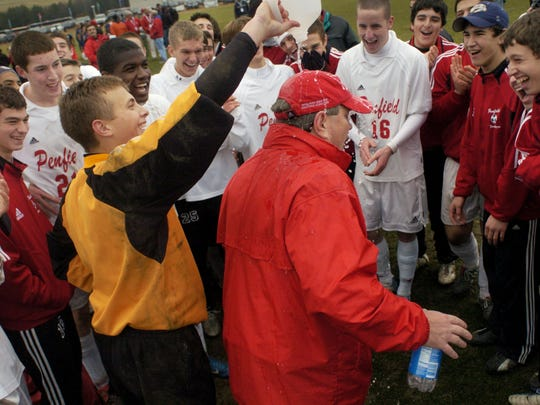 Former Penfield's goal keeper Kyle Zinter dumps a gallon of water on head coach John Butterworth after beating Massapequa in the 2004 State Class AA Boys Soccer Championship.