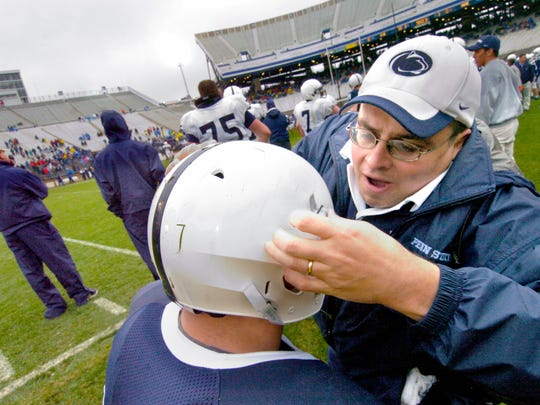 Brad Caldwell, more commonly known as 'Spider,' adjusts a player's helmet before the spring Blue-White intrasquad game in 2006.