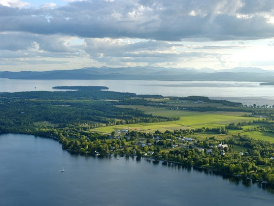 A view of Lake Champlain to the southwest in August 2006, with Grand Isle in the foreground and the high peaks of the Adirondack mountains in the rear.