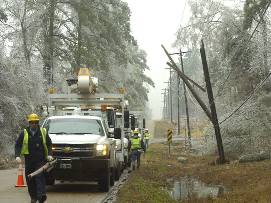 A Cleco crew works on a downed power line on Barron Chapel Road in Pineville in February 2014.