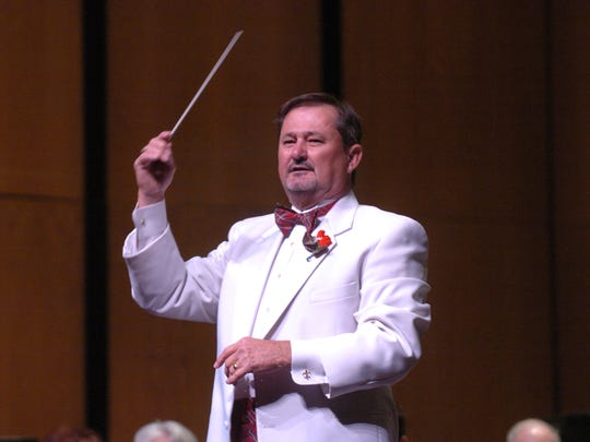 Gerald Guilbeaux directs the Lafayette Concert Band, a community band that started in 1982.