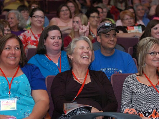 Attendees of a Taste of Home cooking show in Denton, TX watch intently as a culinary specialist teaches them a recipe.
