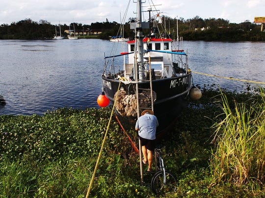 A boat is docked near the LaBelle docks on the Caloosahatchee River.