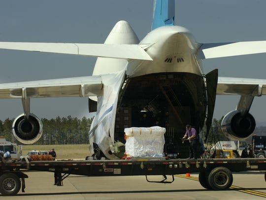Workers unload machinery for making auto parts that was delivered from Germany on an Antonov An-124 jet with a winspan of almost 241 feet at GSP in this 2006 photo. International air cargo flights on a charter basis have touched down at the airport for years, but GSP gets its first regularly scheduled service in November.