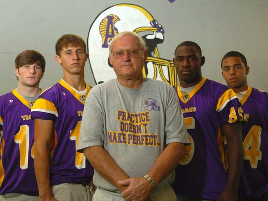 Alexandria Senior High School football coach Butch Stoker (center) stands in front of his leading players from 2007 (from left) Jamie Bunting, Caleb Lonsberry, Reggie Toomer and Clint Boykins.