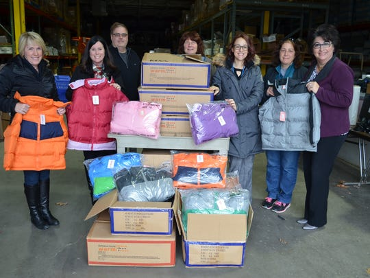 State Rep. Laura Cox (far left) and Livonia Public Schools Superintendent Andrea Oquist (far right) are joined by teachers Colleen Nowak and Catherine Trapp, along with LPS warehouse staff, who helped facilitate the winter coat donation.