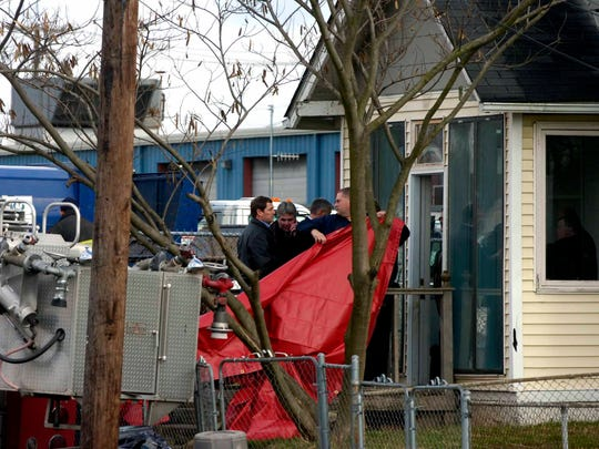 Authorities recover the body of Channon Christian from a house on Jan. 9, 2007, at 2316 Chipman St.