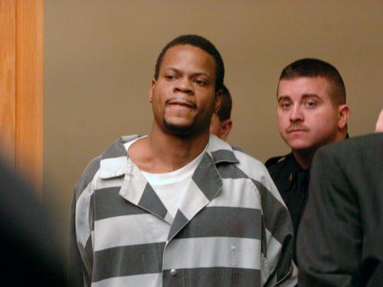 Suspect Lemaricus Davidson arrives for his arraignment