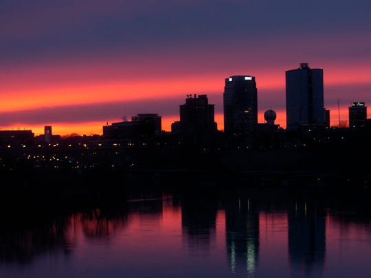 The Knoxville skyline is pictured in silhouette Friday,