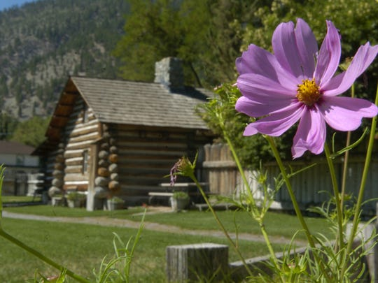 Mormon Station State Park: Flowers are shown in 2005 near the log cabin/museum building at Mormon Station State Park in Genoa.