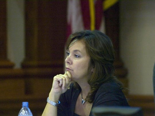 Former Lee County Commissioner Tammy Hall listens to attendees as they address the commission during its second budget workshop at the Old County Courthouse in downtown Fort Myers on Aug. 31, 2010. Hall secretly recorded conversations as she worked with federal investigators.