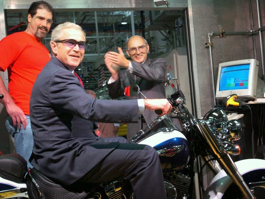 President George W. Bush starts up a Harley Softtail deluxe during his tour of the manufacturing plant in Springettsbury Township.