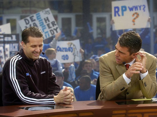 February 26, 2005 - Tiger basketball fans create a rowdy backdrop as Coach John Calipari and Chris Fowler prepare for an interview during the filming of ESPN's College GameDay outside the FedExForum Saturday morning.