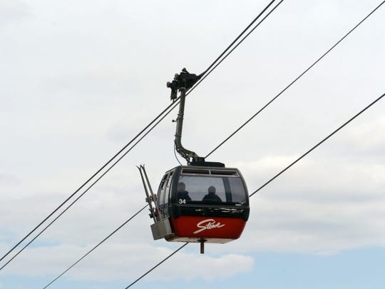 Two skiers ride the gondola up Mt. Mansfield at Stowe Mountain Resort