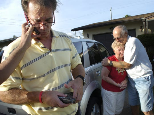 12/10/2008--Photo by Craig Bailey/Florida Today--William Dillon talks on the phone as his parents Joe and Amy celebrate the news that all charges have been dropped against him.