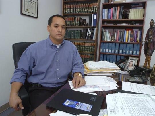 Attorney Mark Smith is shown in his office in Hagåtña