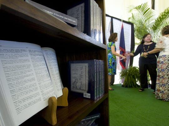 In this file photo, copies of Guam's official Chamorro-English dictionary were displayed during its unveiling at the Chamorro Village in Hagåtña.