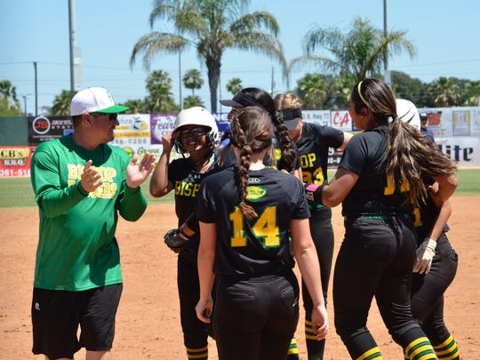 The Bishop softball team cheers after they won a recent game.
