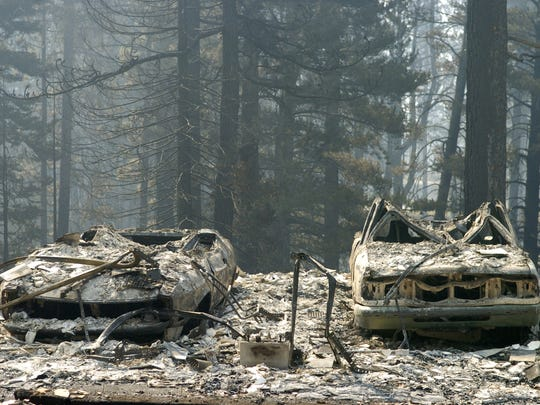 The Skeleton of two cars is all that is left at a South Lake Tahoe home that was destroyed by the Angora Fire.