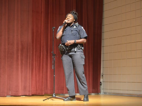 "Murfreesboro Police officer Skyler Harris opened the discussion with a performance of ""If I Can Help Somebody,"" Saturday afternoon at Patterson Park Comunity Center before a panel talk about street and gang violence in Murfreesboro and Rutherford County as a whole."