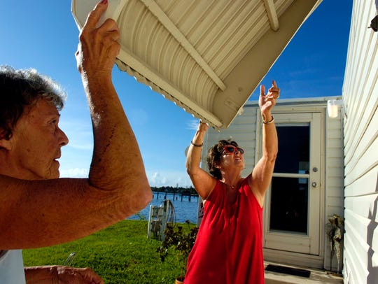Residents in the town of Ocean Breeze prepare a home