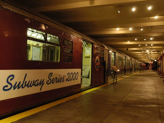 A line up of subway trains on display at the  New York