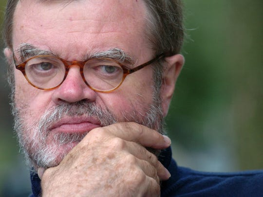 Garrison Keillor pauses during an interview outside of his bookstore while sitting at Nina's Coffee Cafe in Saint Paul, Minn., Aug. 28, 2007.