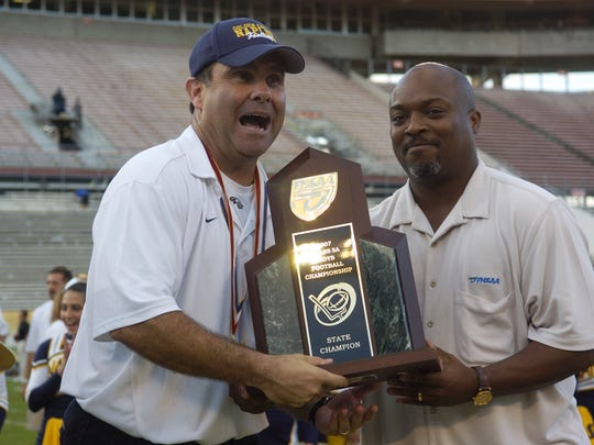 Naples head coach Bill Kramer holds the state championship