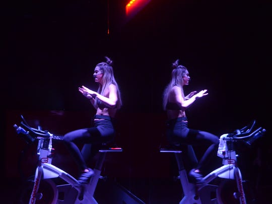 Instructors control the lighting, music and pace at CycleBar Hendersonville.