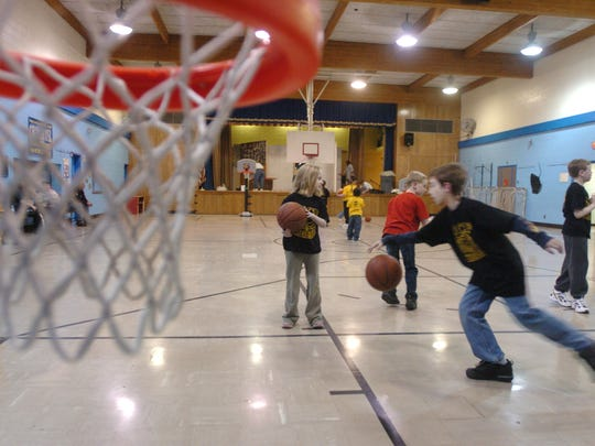 Young athletes play a game of basketball at the Maple