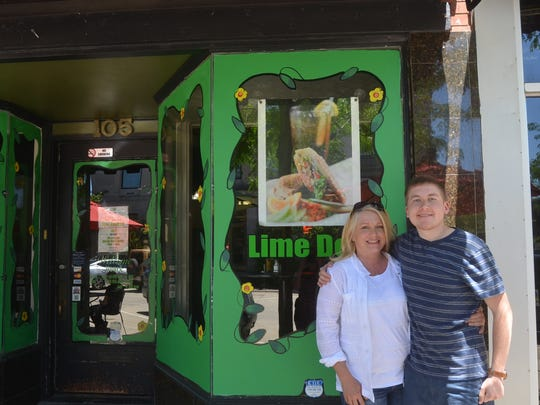 Cheryl Jenkins has painted the windows of many Gallatin businesses, including the Lime Deli. Her son, Logan, often tags along.