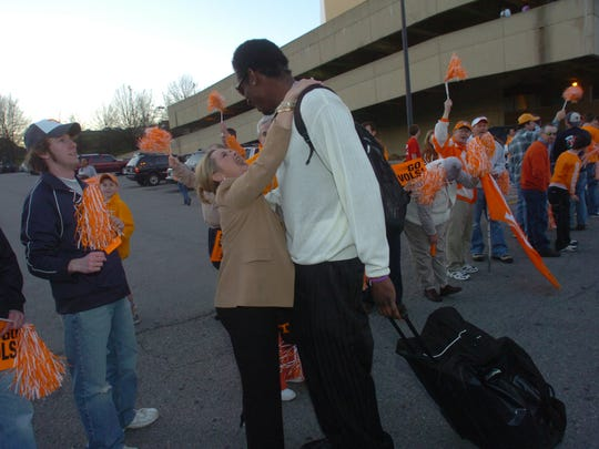 "Tennessee cheerleader's coach Joy Postell gives 6'10"" center Major Wingate a hug during the men's basketball team's send off to the NCAA tournament Tuesday, March 14, 2006, at Thompson-Boling Arena."