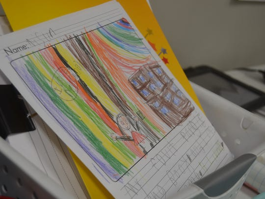 Students draw, color and write as part of their learning