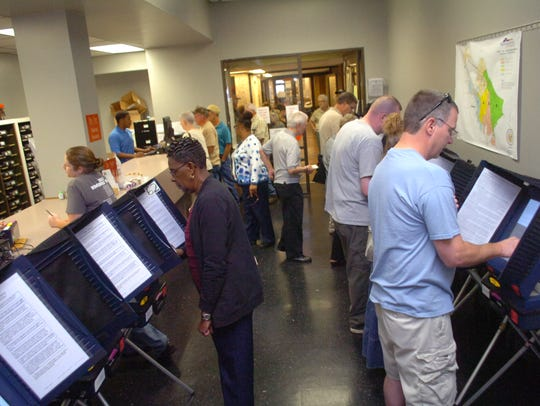 Residents line up for early voting at the Rapides Parish
