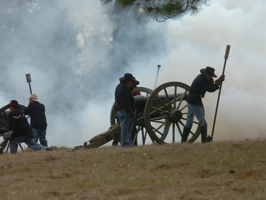 Soldiers fire a cannon during a Civil War battle re-enactment