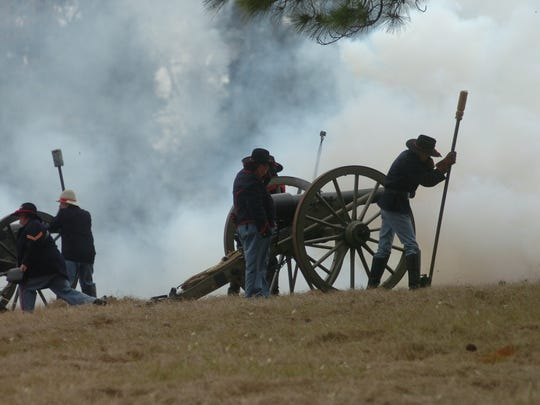Soldiers fire a cannon during a Civil War battle re-enactment at Forts Randolph & Buhlow in 2016. Stakeholders fear an eroding levee will make the historic site in Pineville inaccessible.