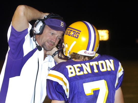Former Benton head coach Mitch Downey talks with Jeffrey Thomisee during the game against North Caddo in 2006.