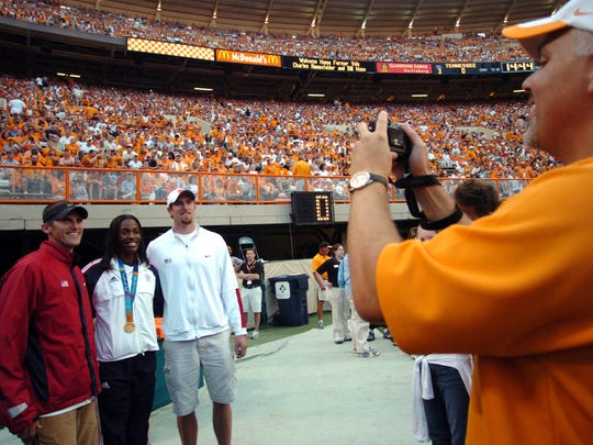 U.S. Olympians Tim Mack, Dee Dee Trotter, and Tom Pappas pose for a photo before the UT/ Louisiana Tech game.