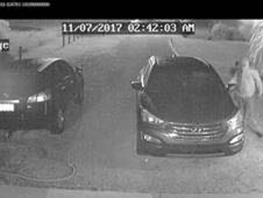 Surveillance video still from one of two dozen car